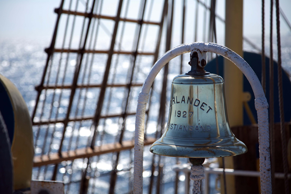 This photo of a ship's bell and rope from a naval vessel provided inspiration for utilising a bell as a means to begin play. Image by Bruno Girin.